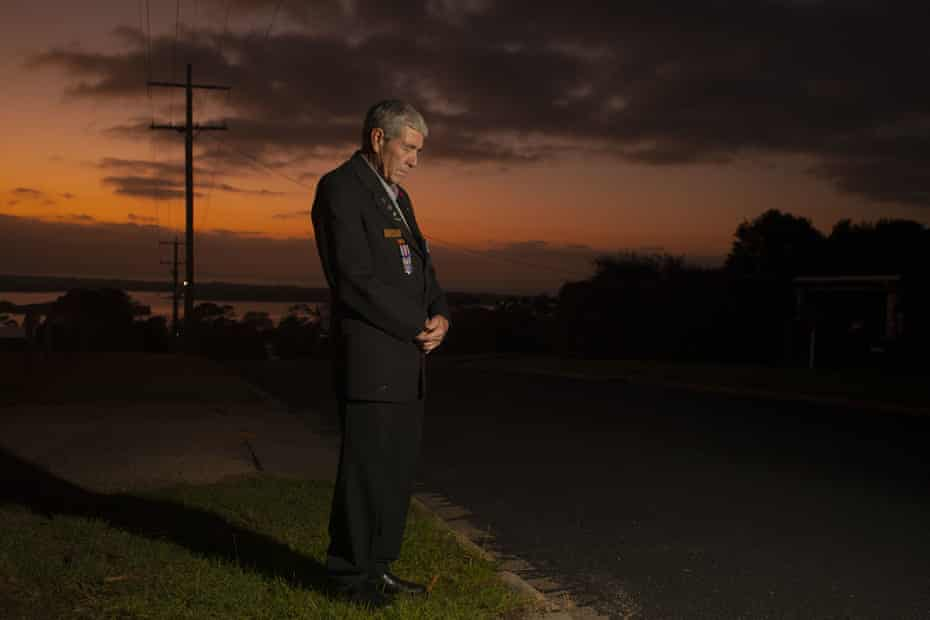 Vietnam Veteran RAAF Engineer David Milligan takes a minutes silence outside his home at dawn in Mallacoota, Far East Gippsland, Saturday, April 25, 2020.
