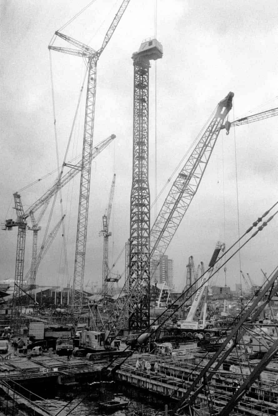 Cranes loom over the area in 1990, at the start of the project. Some residents can barely remember a time when they weren't there.