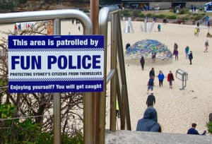 """A """"fun police"""" sign installed at a beach."""