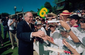 John Howard greets schoolchildren during a match between the Prime Minister's XI Australian team and the West Indies in 1996