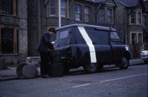 Nick Mason loading his drum kit into a Bedford van in Cambridge, 1965