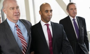 Mohamed Noor (centre) at court with his lawyers Thomas Plunkett (left) and Peter Wold in Minneapolis