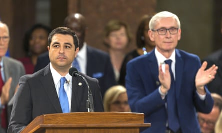 The Wisconsin attorney general, Josh Kaul, left, and Governor Tony Evers were elected in 2018 but have been frustrated by restrictive laws passed by the Republican legislature.