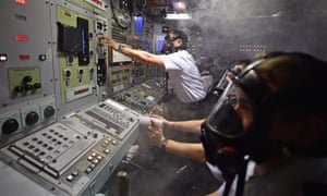 Navy personnel respond to a fire in the control room of a simulator of a Vanguard Class nuclear-powered ballistic missile submarine.