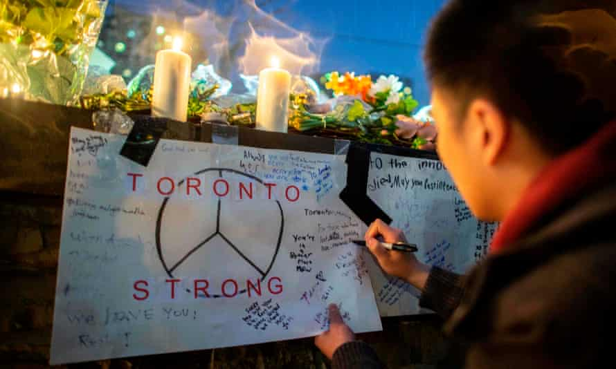 A makeshift shrine near the site in Toronto where Alek Minassian killed 10 people by driving his van on to the pavement.