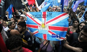 Argentinian activists hold a poster reading 'We will be back!' during a demonstration in 2012 over the disputed Falklands/Malvinas islands.