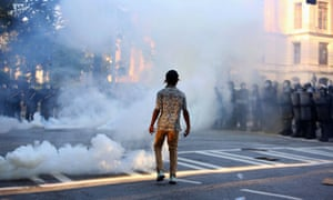 A protester stands amidst tear gas during a protest in Atlanta against the death of George Floyd.