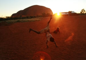 A child plays at sunset in the Aboriginal community of Mutitjulu, in the shadow of Uluru