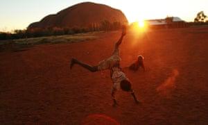 Aboriginal children playing near Uluru