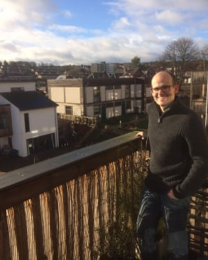 Max Folkett on the balcony of his two-bed flat at Lilac in Leeds.