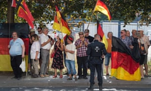 Pegida supporters protest against Angela Merkel's visit to Dresden, Saxony.