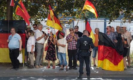 Pegida supporters protest against Angela Merkel's visit to Dresden, Saxony.