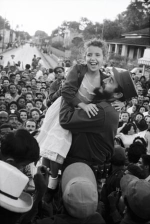 Burt Glinn: Castro lifts a young admirer on the march to Havana. Cuba. 1959