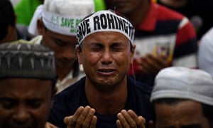 An ethnic Rohingya Muslim refugee breaks down during a protest in Kuala Lumpur , Malaysia