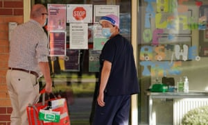 Medical personnel are seen outside the Florence aged care facility amid the second wave of the coronavirus in Melbourne.