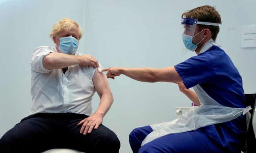 Boris Johnson receiving his second dose of the Covid-19 vaccine in June.