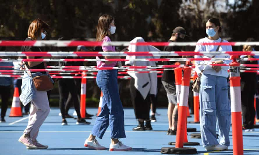 People queue at a Covid-19 vaccination centre in Melbourne on Wednesday.