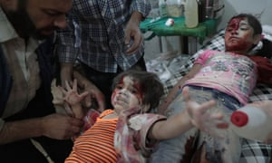 Two Syrian girls in a make-shift hospital following reported government air strikes on the rebel-held town of Douma hours before a ceasefire began on Monday.