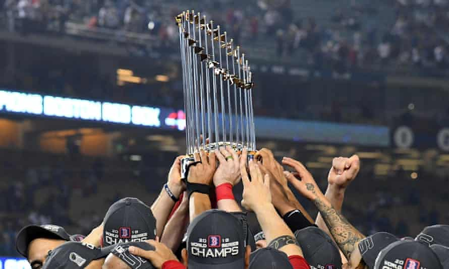 The Boston Red Sox players hoist the Commissioner's Trophy after defeating the Los Angeles Dodgers to win the 2018 World Series