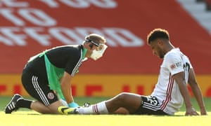 Lys Mousset of Sheffield United receives medical treatment from a member of the medical staff.
