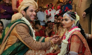 The daughter of Gali Janardhan Reddy, Bramhani, with her groom, Rajeev Reddy, during their wedding at the Bangalore Palace Grounds in Bangalore