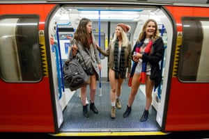Passengers wear no trousers as they ride the London Underground in London, Britain