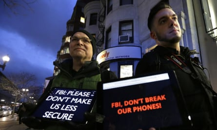 Demonstrators display iPads with messages against FBI's proposals to weaken data security on their screens, outside an Apple store in Boston in February 2016.