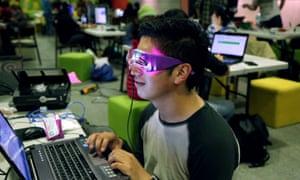 Robotic engineer Octavio Martinez tests out his prototype to measure REM sleep.