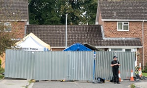 Police and forensic tents outside home