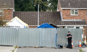 A police officer outside Sergei Skripal's home in Salisbury
