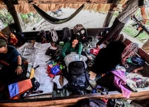 Ka Kathryn with her belongings inside a makeshift hut
