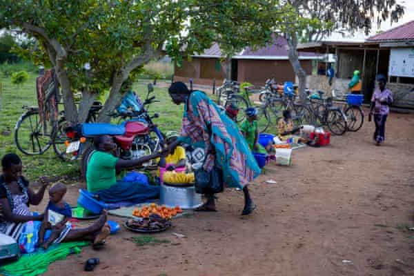 Women at a small marketplace in Okere City