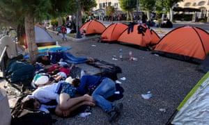 Syrian refugees sleep on the street on Kos, Greece