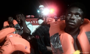 People being rescued before boarding the French NGO's ship Aquarius.