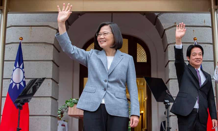 Taiwan president Tsai Ing-wen (C) and Vice President William Lai wave during their inauguration in Taipei on Wednesday.