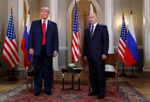 Trump and Putin pose for the media