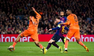 Lionel Messi converts Barcelona's crucial third goal against a spirited Lyon.
