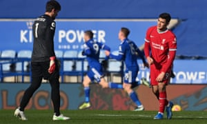 Liverpool goalkeeper Alisson (left) stands dejected alongside Ozan Kabak as Leicester City's Jamie Vardy celebrates scoring their sides second goal.