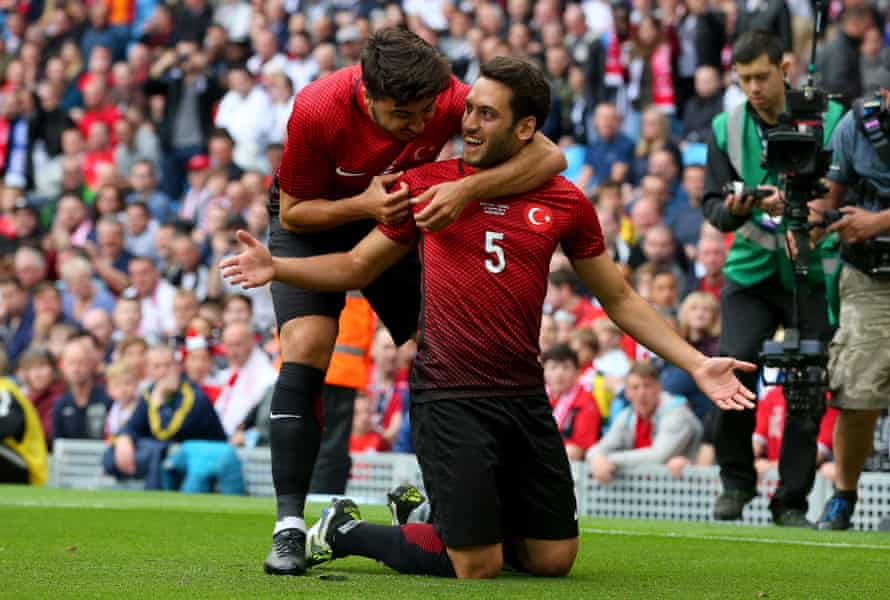 Hakan Calhanoglu celebrates after scoring Turkey's goal against England