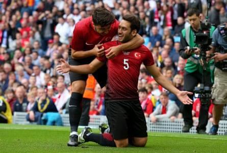 Hakan Calhanoglu celebrates after scoring Turkey's goal against England