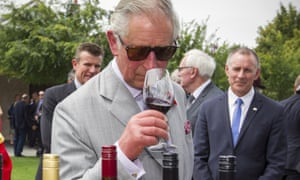 Prince Charles samples a red wine