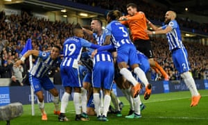 The Brighton players celebrate Pascal Gross' goal.