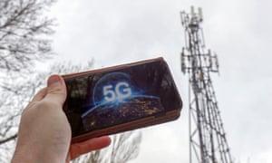 A 5G phone next to a telecoms mast near Wokingham, Berkshire.
