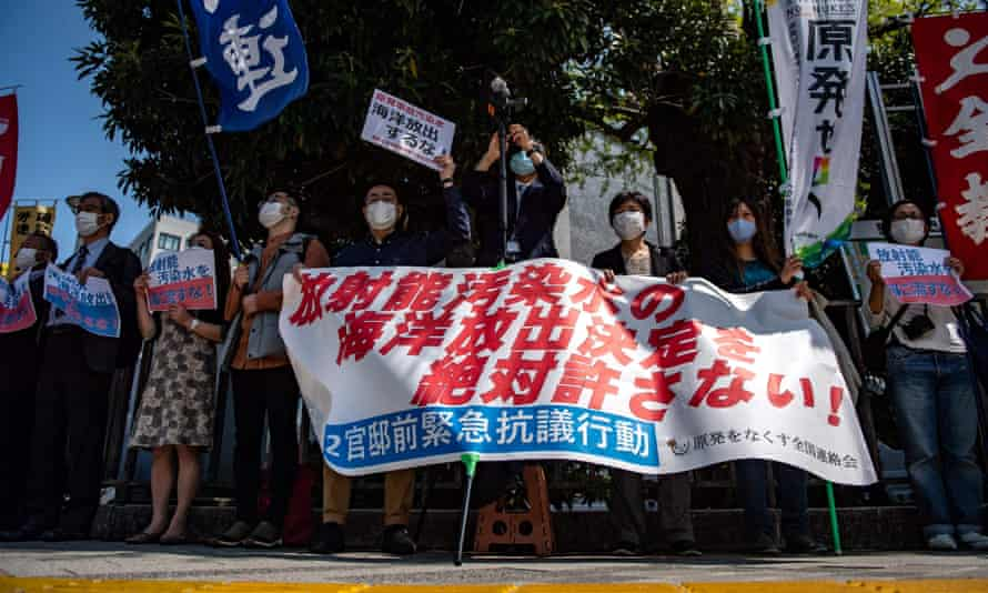 Activists take part in a protest against the Japan government's plan to release treated water from the stricken Fukushima nuclear plant into the sea