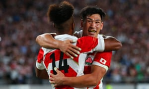 Kotaro Matsushima of Japan celebrates scoring the fourth try with team mate Ryoto Nakamura during his side's 30 - 10 win over Russia.