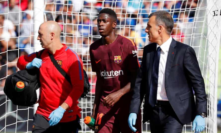 Ousmane Dembele walks off the pitch after being injured against Getafe.