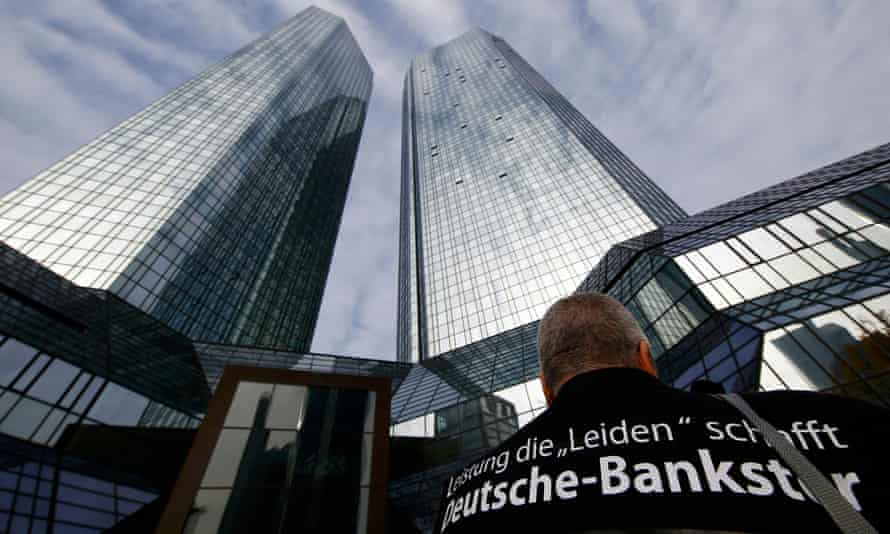 A protester outsider Deutsche Bank HQ in Frankfurt, Germany
