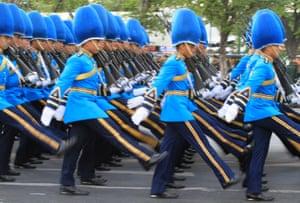 Bangkok, Thailand. The King's Guard march during a parade celebrating the 88th birthday of King Bhumibol