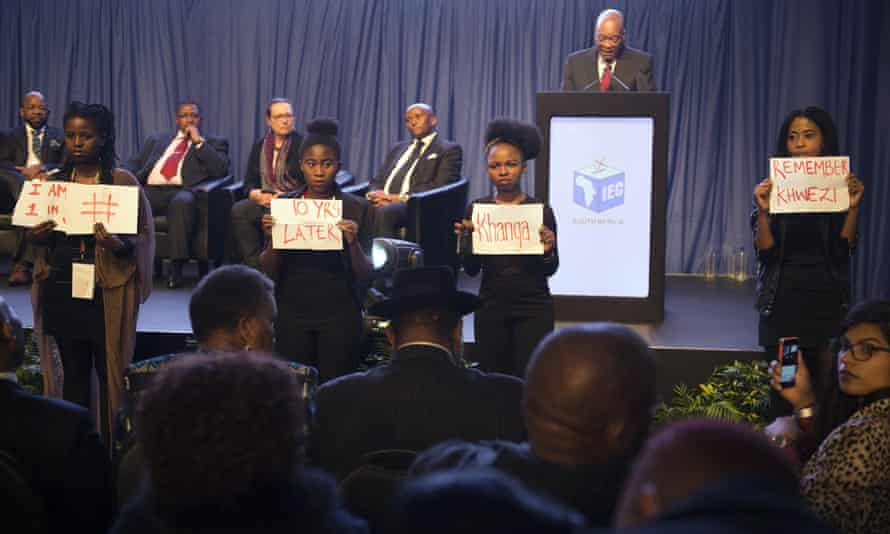 Protesters brandish reminders of Jacob Zuma's rape acquittal a decade ago