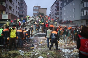 A rescue mission is carried out on the debris of a seven-storey building after it collapsed in the district of Kartal.